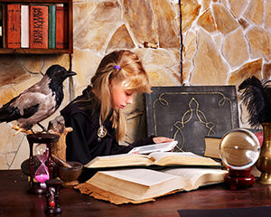 Halloween girl reading ghost stories